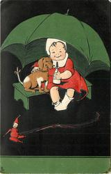 child with bottle & dachshund sit under umbrella