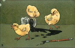 three chicks, one sits on tipped over ink well