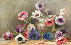 ANEMONES  bluish green vase surrounded by anemones lying on the ground, in the vase the flowers are pink, white and purple