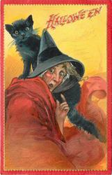 witch looks scared, has black cat on shoulder, her left hand by her face