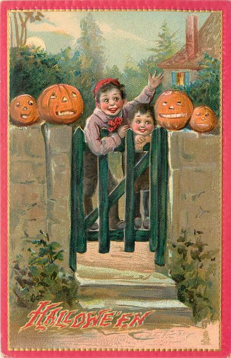 two boys at gate, four Jack o Lanterns on wall