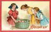three girls around tub of water and apples