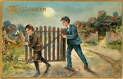 two boys carry wooden gate to left