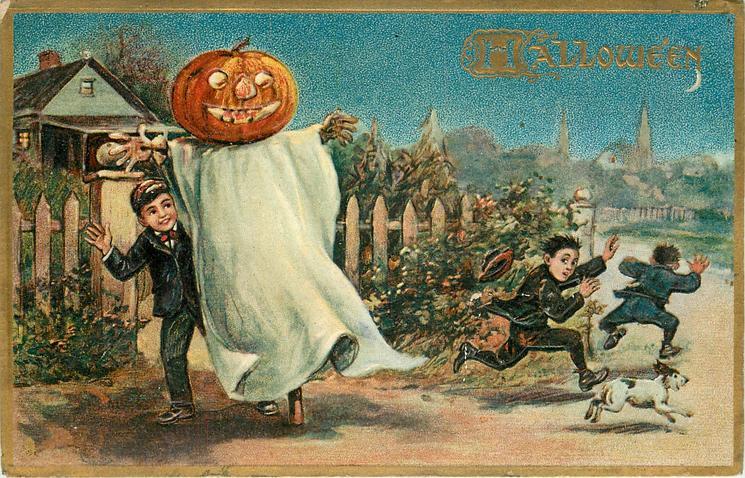 boy holds sheet with jack-o-lantern head, two boys and dog run away