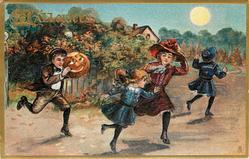 boy runs with Jack-o-Lantern as a head, woman holds hat, two girls run