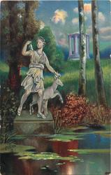 silver-lit statue in pond of huntress Diana with deer