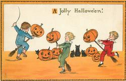 A JOLLY HALLOWE'EN!  boys run with Jack-o-Lanterns on broomsticks
