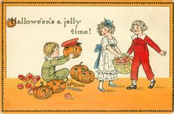 HALLOWE'EN'S A JOLLY TIME!  boy shows Jack-o-Lantern to boy & girl carrying apples