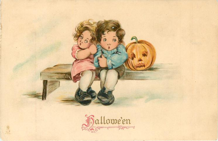 HALLOWE'EN  girl and boy sitting on bench with jack o'lantern