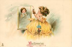 HALLOWE'EN  little girl holds candle up to mirror & sees face of boy