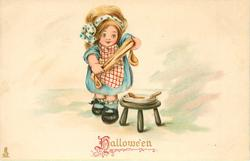 HALLOWE'EN  girl stands by stool with plate on it