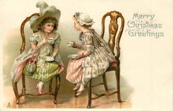 MERRY CHRISTMAS GREETINGS  two overdressed girls take tea