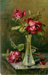 two red roses open in vase & three buds, rose & bud on table