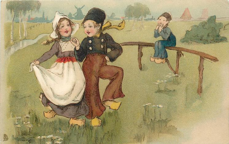 Dutch boy & girl dance, boy observes sitting on fence by path