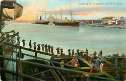 COALING A STEAMER AT PORT SAID  two big ships behind, buildings right
