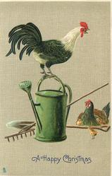 rooster on top of watering can, hen with three chicks looks on, hoe and rake