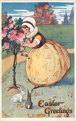 EASTER GREETINGS  girl in old style dress tends rose bush, two rabbits below