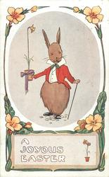 A JOYOUS EASTER  dressed rabbit faces front carrying pot with one daffodil init