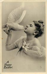 A HAPPY EASTER  girl holds dove, kisses it, lily corsage