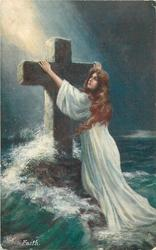 FAITH  girl holds to large stone cross, waves