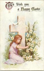 TO WISH YOU A HAPPY EASTER  girl in pink, by cross, touches lilies, dove above