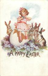 A HAPPY EASTER  girl standing in large egg-shell, four rabbits