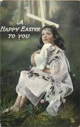 A HAPPY EASTER TO YOU  girl sitting down holding a lamb, facing front