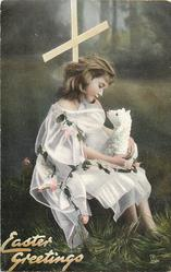 EASTER GREETINGS  girl facing right looking down at lamb she is holding in her lap