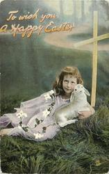 TO WISH YOU A HAPPY EASTER  girl lies on grass holding a lamb, facing front/up