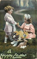 A HAPPY EASTER  standing boy gives chick to seated girl, stuffed rabbit & eggs on ground