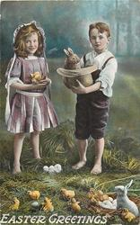 EASTER GREETINGS  boy holds stuffed rabbit in hat, girl holds chicks, many chicks & rabbit on ground