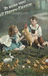 TO WISH YOU A HAPPY EASTER  seated boy & girl caress stuffed chicken, rabbit chicks & eggs in  foreground