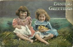 EASTER GREETINGS  two girls sit on grass, one holds stuffed rabbit, the other chicks