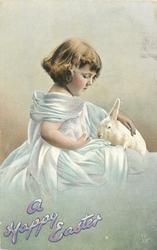 A HAPPY EASTER  girl sits facing right, looking down at rabbit on her lap