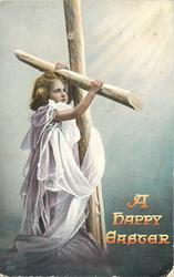 A HAPPY EASTER  girl faces partly right, looks up, she is below cross & holds on with both hands