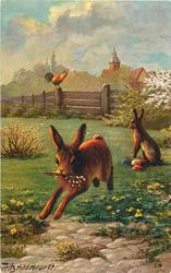 rabbit runs front with pussy willow in mouth, another sits behind with eggs