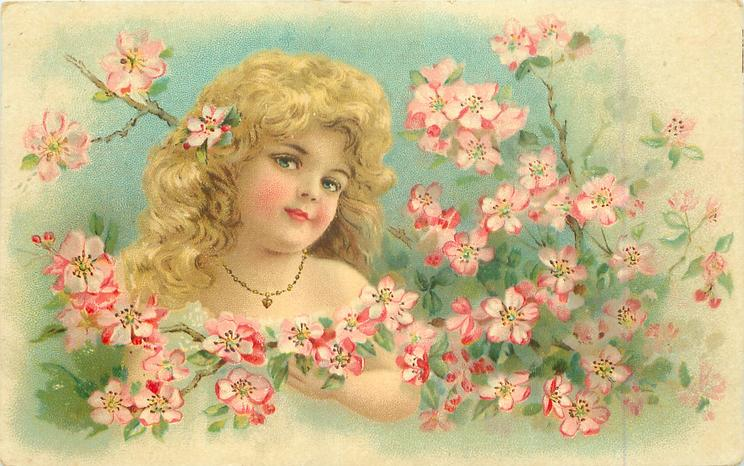 head & shoulder study of blond girl amidst apple blossom