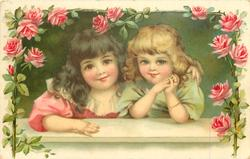 two girls lean on window sill, framed by pink roses
