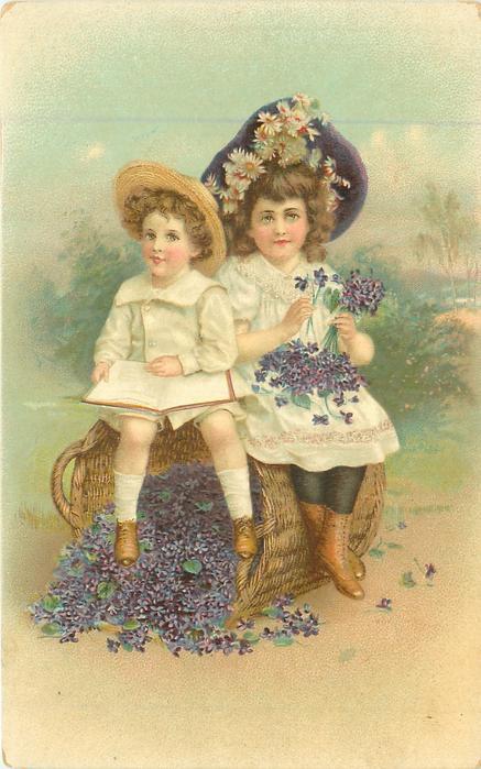 boy & girl sit on basket of violets