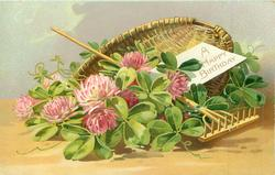 A HAPPY BIRTHDAY  basket of clover flowers, rake across basket, card inside