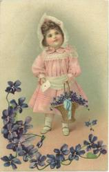 girl in pink holds letter in right hand, basket of violets in left, violets along bottom