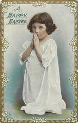 A HAPPY EASTER  girl in white smock faces front/left, on knees praying
