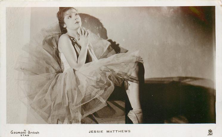 JESSIE MATTHEWS  seated, in dance costume