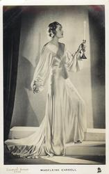 MADELEINE CARROLL  standing on step carrying candle