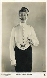 CICELY COURTNEIDGE  in boy's uniform, looking front