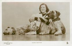 DIANA COTTON  she sits on floor with two mastifs, one each sides