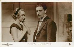 IVOR NOVELLO AND KAY HAMMOND  he right, looks left/front, she looks down, touches her left ear with left hand