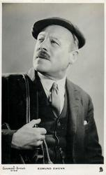 EDMUND GWENN  looks left, faces slightly right, wears dark suit and hat