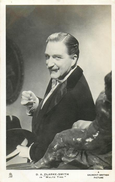"D. A. CLARKE-SMITH IN ""WALTZ TIME""  he holds black hat in left hand"
