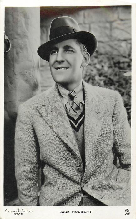 JACK HULBERT  wears suit & hat, looks left, faces front